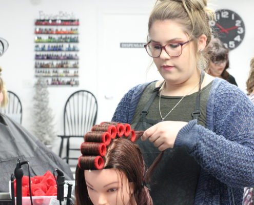 practicing styling hair | beauty academy in Marietta, OH | Preston's Beauty Academy