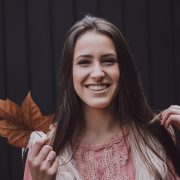 woman holding a fall leaf | Beauty Academy in Marietta, OH | Preston's Beauty Academy